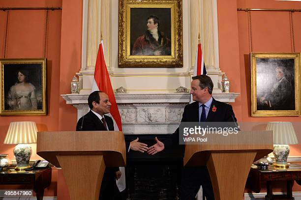 British Prime Minister David Cameron shakes hands with Egyptian President Abdel Fattah elSisi during their news conference at 10 Downing Street...
