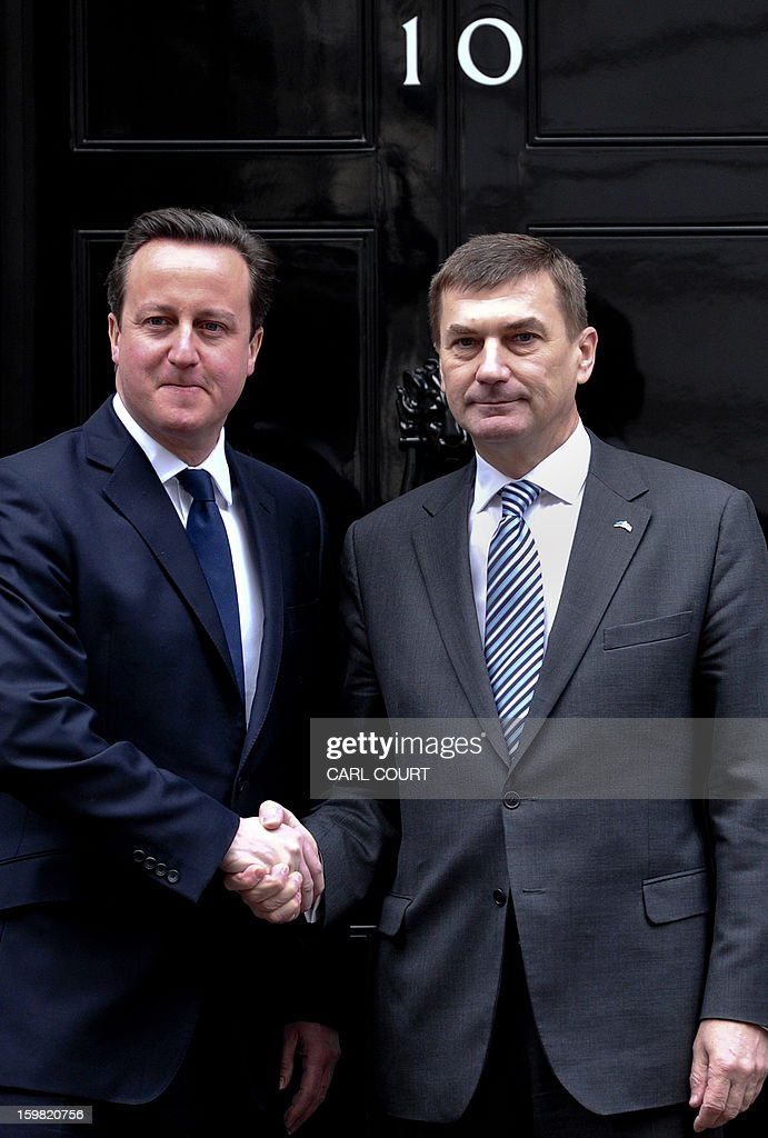 British Prime Minister David Cameron (L) shakes hands with Estonian Prime Minister Andrus Anslip (R) ahead of a meeting at 10 Downing Street in central London on January 21, 2013.