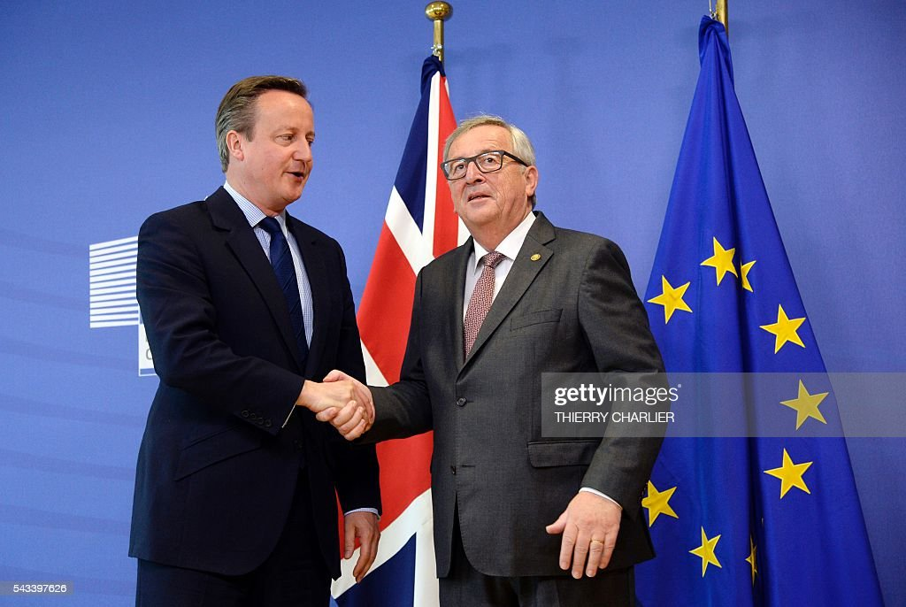 British Prime Minister David Cameron (L) shakes hands with European Union Commission President Jean-Claude Juncker (R) prior to a meeting at the European Union Commission headquarters in Brussels on June 28, 2016. / AFP / THIERRY