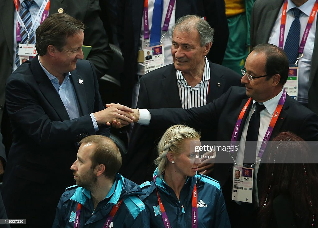 British Prime Minister <a gi-track='captionPersonalityLinkClicked' href=/galleries/search?phrase=David+Cameron+-+Politician&family=editorial&specificpeople=227076 ng-click='$event.stopPropagation()'>David Cameron</a> shakes hands with French President Francois Hollande after the Women's Handball Preliminaries Group B - Match 10 between France and Spain on Day 3 of the London 2012 Olympic Games at the Copper Box on July 30, 2012 in London, England.