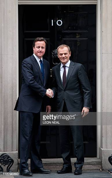 British Prime Minister David Cameron shakes hands with his Polish counterpart Donald Tusk on the step of 10 Downing Street in central London on April...