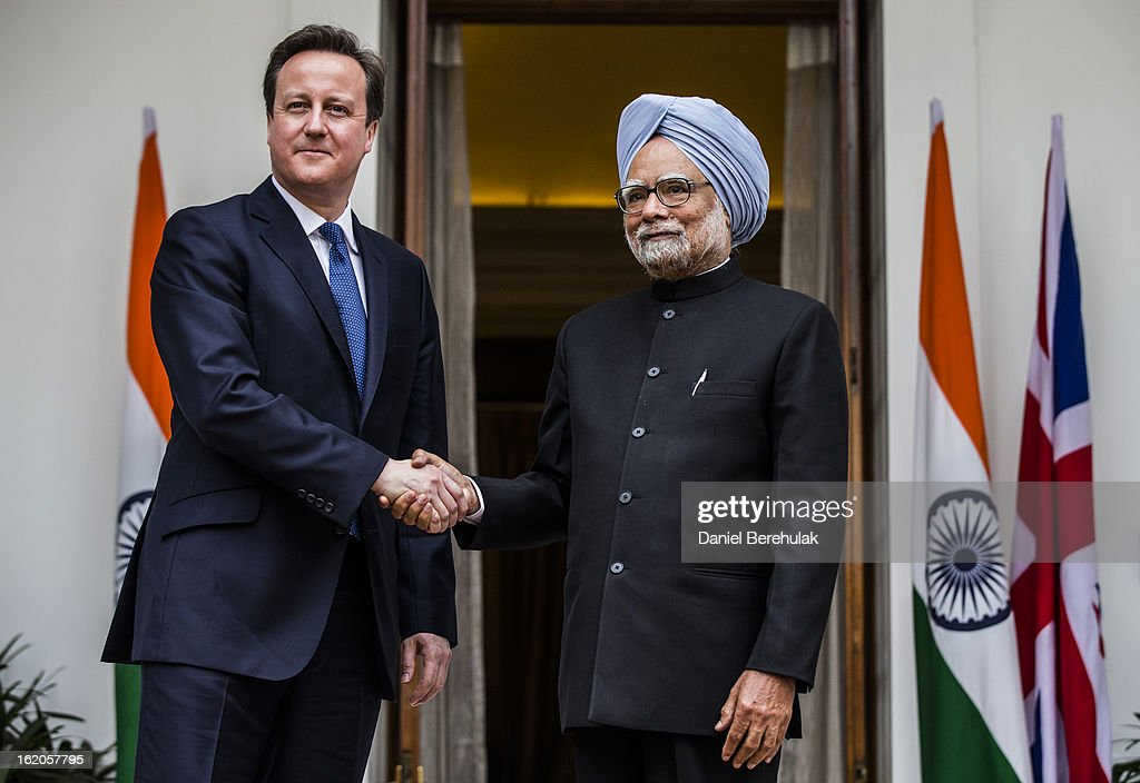British Prime Minister <a gi-track='captionPersonalityLinkClicked' href=/galleries/search?phrase=David+Cameron+-+Politicus&family=editorial&specificpeople=227076 ng-click='$event.stopPropagation()'>David Cameron</a> shakes hands with Indian Prime Minister <a gi-track='captionPersonalityLinkClicked' href=/galleries/search?phrase=Manmohan+Singh&family=editorial&specificpeople=227120 ng-click='$event.stopPropagation()'>Manmohan Singh</a> at Hyderabad House on February 19, 2013 in New Delhi, India. British Prime Minister <a gi-track='captionPersonalityLinkClicked' href=/galleries/search?phrase=David+Cameron+-+Politicus&family=editorial&specificpeople=227076 ng-click='$event.stopPropagation()'>David Cameron</a> arrived in India on Monday for an official three-day trip accompanied by a large business delegation from the UK.