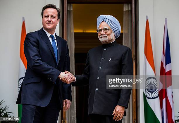 British Prime Minister David Cameron shakes hands with Indian Prime Minister Manmohan Singh at Hyderabad House on February 19 2013 in New Delhi India...
