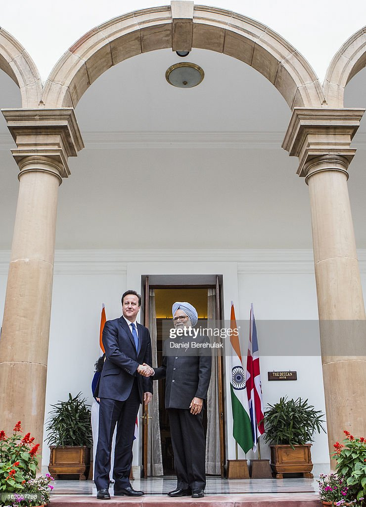 British Prime Minister <a gi-track='captionPersonalityLinkClicked' href=/galleries/search?phrase=David+Cameron+-+Politiker&family=editorial&specificpeople=227076 ng-click='$event.stopPropagation()'>David Cameron</a> shakes hands with Indian Prime Minister <a gi-track='captionPersonalityLinkClicked' href=/galleries/search?phrase=Manmohan+Singh&family=editorial&specificpeople=227120 ng-click='$event.stopPropagation()'>Manmohan Singh</a> at Hyderabad House on February 19, 2013 in New Delhi, India. British Prime Minister <a gi-track='captionPersonalityLinkClicked' href=/galleries/search?phrase=David+Cameron+-+Politiker&family=editorial&specificpeople=227076 ng-click='$event.stopPropagation()'>David Cameron</a> arrived in India on Monday for an official three-day trip accompanied by a large business delegation from the UK.