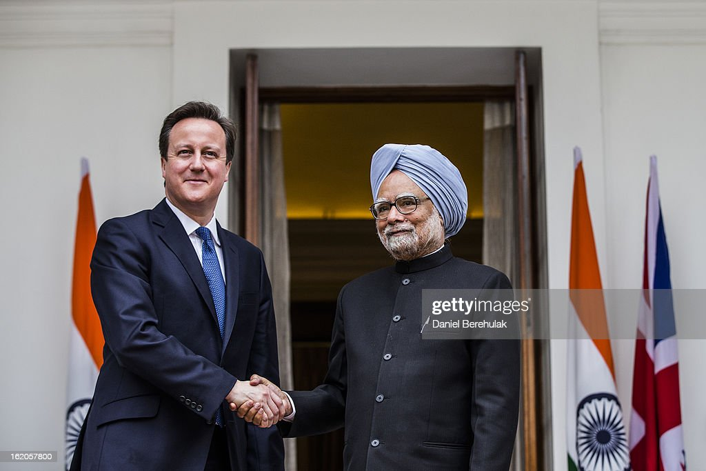 British Prime Minister <a gi-track='captionPersonalityLinkClicked' href=/galleries/search?phrase=David+Cameron+-+Politician&family=editorial&specificpeople=227076 ng-click='$event.stopPropagation()'>David Cameron</a> shakes hands with Indian Prime Minister <a gi-track='captionPersonalityLinkClicked' href=/galleries/search?phrase=Manmohan+Singh&family=editorial&specificpeople=227120 ng-click='$event.stopPropagation()'>Manmohan Singh</a> at Hyderabad House on February 19, 2013 in New Delhi, India. British Prime Minister <a gi-track='captionPersonalityLinkClicked' href=/galleries/search?phrase=David+Cameron+-+Politician&family=editorial&specificpeople=227076 ng-click='$event.stopPropagation()'>David Cameron</a> arrived in India on Monday for an official three-day trip accompanied by a large business delegation from the UK.