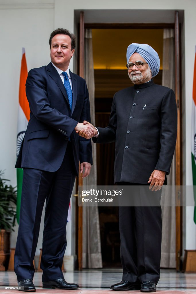 British Prime Minister David Cameron shakes hands with Indian Prime Minister Manmohan Singh at Hyderabad House on February 19, 2013 in New Delhi, India. British Prime Minister David Cameron arrived in India on Monday for an official three-day trip accompanied by a large business delegation from the UK.