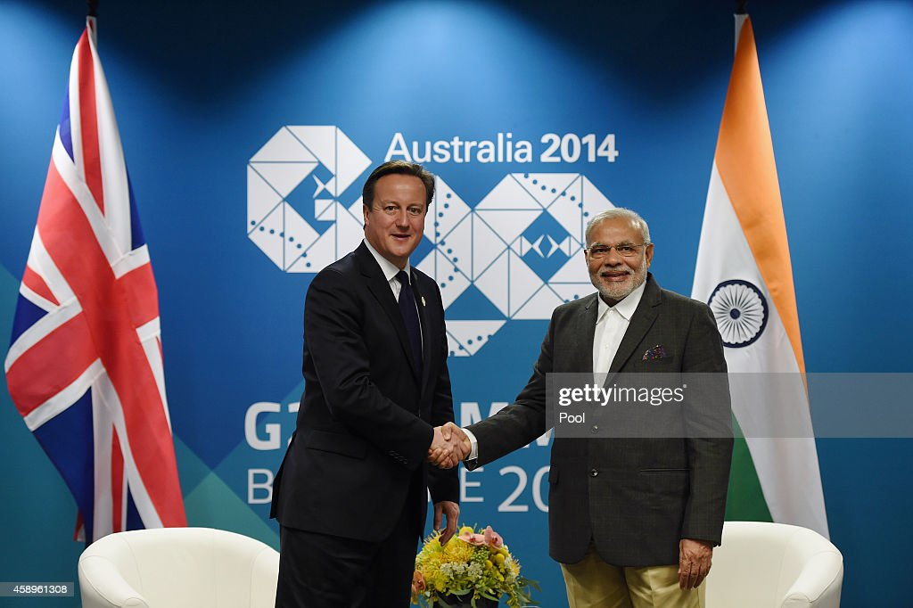 British Prime minister <a gi-track='captionPersonalityLinkClicked' href=/galleries/search?phrase=David+Cameron+-+Politician&family=editorial&specificpeople=227076 ng-click='$event.stopPropagation()'>David Cameron</a> (left) shakes hands with Indian Prime Minister <a gi-track='captionPersonalityLinkClicked' href=/galleries/search?phrase=Narendra+Modi&family=editorial&specificpeople=822611 ng-click='$event.stopPropagation()'>Narendra Modi</a> during a bilateral meeting at the Brisbane Convention and Exhibitions Centre (BCEC) on November 14, 2014 in Brisbane Australia. World leaders have gathered in Brisbane for the annual G20 Summit and are expected to discuss economic growth, free trade and climate change as well as pressing issues including the situation in Ukraine and the Ebola crisis.