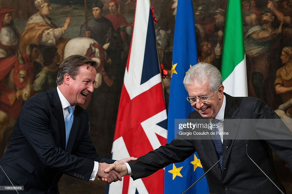 British Prime Minister David Cameron (L) shakes hands with Italian Prime Minister Mario Monti during a press conference at Palazzo Chigi on November 13, 2012 in Rome, Italy. During the press conference David Cameron said that the European Union needs a banking union and Britain stands ready to support the initiative to the extent that financial mechanisms are safeguarded.