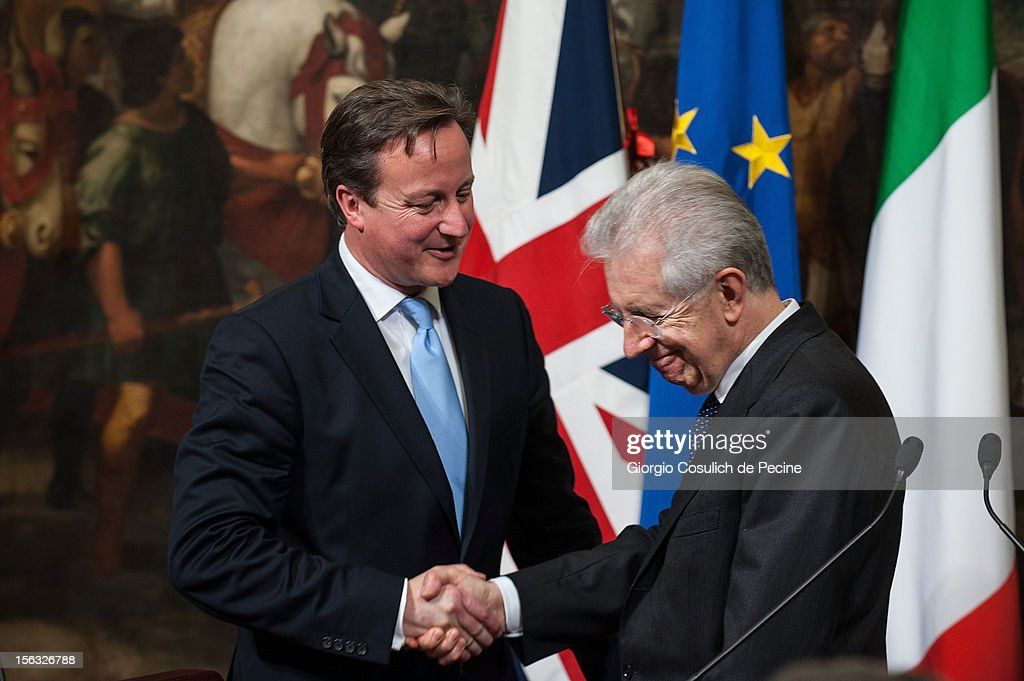 British Prime Minister <a gi-track='captionPersonalityLinkClicked' href=/galleries/search?phrase=David+Cameron+-+Politician&family=editorial&specificpeople=227076 ng-click='$event.stopPropagation()'>David Cameron</a> (L) shakes hands with Italian Prime Minister <a gi-track='captionPersonalityLinkClicked' href=/galleries/search?phrase=Mario+Monti&family=editorial&specificpeople=632091 ng-click='$event.stopPropagation()'>Mario Monti</a> during a press conference at Palazzo Chigi on November 13, 2012 in Rome, Italy. During the press conference <a gi-track='captionPersonalityLinkClicked' href=/galleries/search?phrase=David+Cameron+-+Politician&family=editorial&specificpeople=227076 ng-click='$event.stopPropagation()'>David Cameron</a> said that the European Union needs a banking union and Britain stands ready to support the initiative to the extent that financial mechanisms are safeguarded.