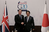 British Prime Minister David Cameron shakes hands with Japanese Prime Minister Shinzo Abe during a bilateral meeting on day one of the G20 Turkey...