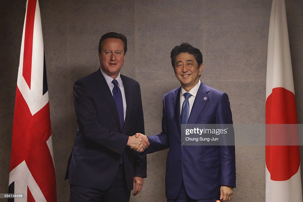 British Prime Minister <a gi-track='captionPersonalityLinkClicked' href=/galleries/search?phrase=David+Cameron+-+Politician&family=editorial&specificpeople=227076 ng-click='$event.stopPropagation()'>David Cameron</a> (L) shakes hands with Japanese Prime Minister <a gi-track='captionPersonalityLinkClicked' href=/galleries/search?phrase=Shinzo+Abe&family=editorial&specificpeople=559017 ng-click='$event.stopPropagation()'>Shinzo Abe</a> (R) during a bilateral meeting on May 25, 2016 in Shima, Japan. The G7 summit will be held on Japan's Kashikojima Island on May 26 and 27, 2016.