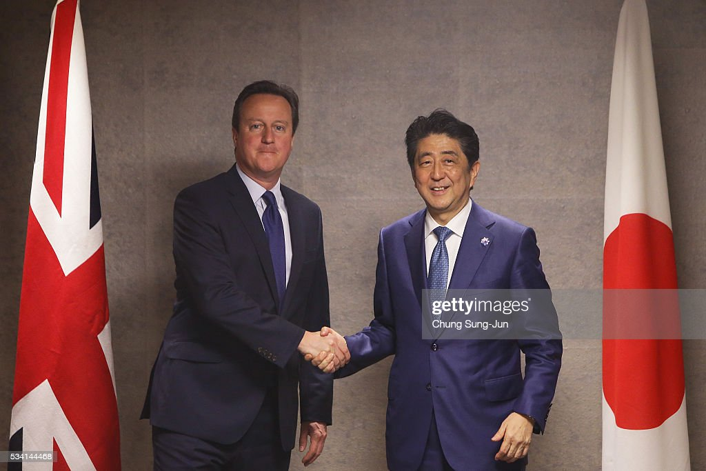 British Prime Minister <a gi-track='captionPersonalityLinkClicked' href=/galleries/search?phrase=David+Cameron+-+Politico&family=editorial&specificpeople=227076 ng-click='$event.stopPropagation()'>David Cameron</a> (L) shakes hands with Japanese Prime Minister <a gi-track='captionPersonalityLinkClicked' href=/galleries/search?phrase=Shinzo+Abe&family=editorial&specificpeople=559017 ng-click='$event.stopPropagation()'>Shinzo Abe</a> (R) during a bilateral meeting on May 25, 2016 in Shima, Japan. The G7 summit will be held on Japan's Kashikojima Island on May 26 and 27, 2016.