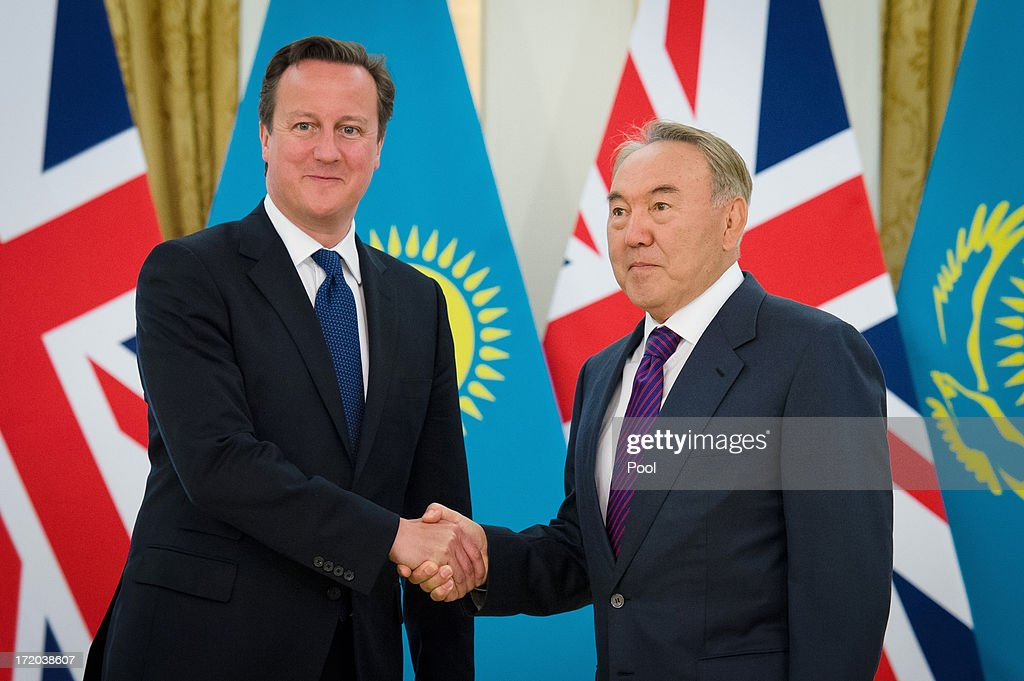 British Prime Minister David Cameron (L) shakes hands with Kazakhstan President Nursultan Nazarbayev after arriving at the Presidential Palace on July 1, 2013 in Astana, Kazakhstan. Cameron is visiting Kazakhstan as part of a trade mission; the first ever trip to the country by a serving British Prime Minister, after making an unannounced trip to visit troops in Afghanistan and meeting with the Prime Minister of Pakistan in Islamabad.