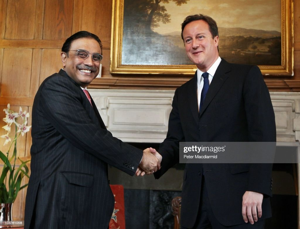 British Prime Minister <a gi-track='captionPersonalityLinkClicked' href=/galleries/search?phrase=David+Cameron+-+Politician&family=editorial&specificpeople=227076 ng-click='$event.stopPropagation()'>David Cameron</a> (R) shakes hands with Pakistan's President <a gi-track='captionPersonalityLinkClicked' href=/galleries/search?phrase=Asif+Ali+Zardari&family=editorial&specificpeople=1125723 ng-click='$event.stopPropagation()'>Asif Ali Zardari</a> on August 6, 2010 at Chequers near Princes Risborough, England. President Zardari has been criticised at home for his diplomatic visit to the UK as the worst flooding in Pakistan's history has killed over 1600 people and affected four million.