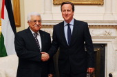 British Prime Minister David Cameron shakes hands with Palestinian President Mahmoud Abbas as he welcomes him at 10 Downing Street on September 11...