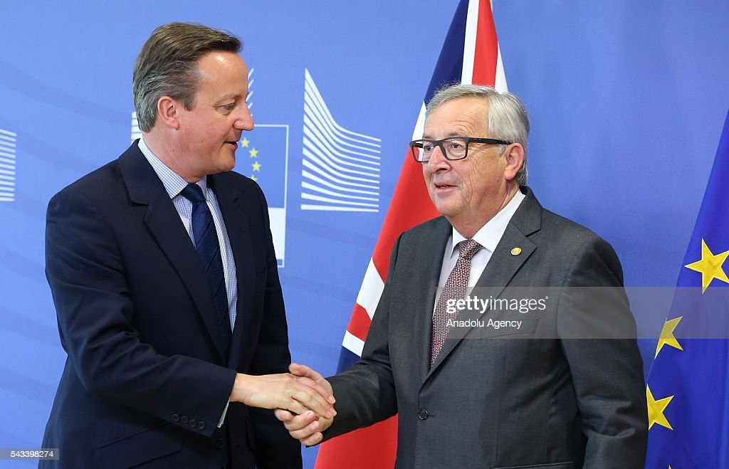 British Prime Minister David Cameron (L) shakes hands with the President of the European Commission, Jean-Claude Juncker ahead of the EU Leaders Summit in Brussels, Belgium on June 28, 2016.