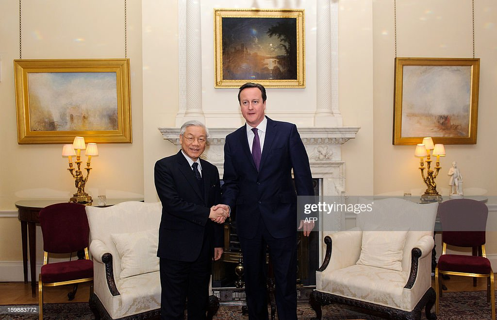 British Prime Minister David Cameron shakes hands with Vietnamese General Secretary of the Communist Party Nguyen Phu Trong before a meeting at 10 Downing Street in central London on January 22, 2013.