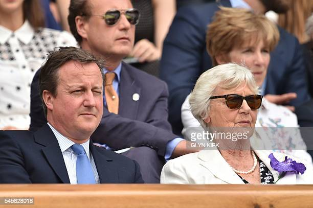 British Prime Minister David Cameron sits by his mother Mary Cameron in the royal box on centre court before the men's singles final match on the...