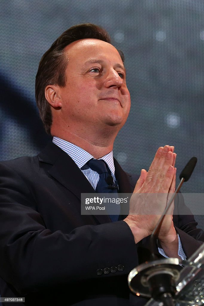 British Prime Minister David Cameron speaks as he welcomes India's Prime Minister Narendra Modi on stage at Wembley Stadium during a welcome rally on November 13, 2015, in London, England. In his first trip to Britain as Prime Minister Modi's visit will aim to develop economic ties between the two countries. In a busy schedule he is due to speak at Wembley Stadium, have lunch with the Queen at Buckingham Palace, address Parliament and stay overnight at Chequers.