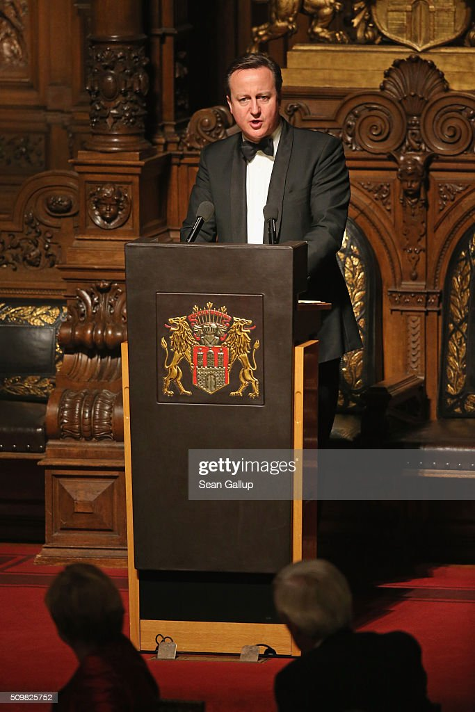 British Prime Minister <a gi-track='captionPersonalityLinkClicked' href=/galleries/search?phrase=David+Cameron+-+Politician&family=editorial&specificpeople=227076 ng-click='$event.stopPropagation()'>David Cameron</a> speaks at the annual Matthiae-Mahl dinner at Hamburg City Hall on February 12, 2016 in Hamburg, Germany. Cameron and German Chancellor Angela Merkel are there on the invitation of Hamburg Mayor Olaf Scholz, who reportedly saw the dinner as a gesture to show Germany's hope that Great Britain will remain in the European Union. The Matthiae-Mahl is a Hamburg tradition dating back to 1356 and began as a fest to welcome the spring season and also to honor a foreign official.