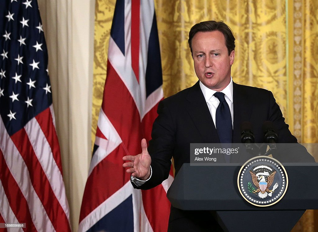 British Prime Minister <a gi-track='captionPersonalityLinkClicked' href=/galleries/search?phrase=David+Cameron+-+Politician&family=editorial&specificpeople=227076 ng-click='$event.stopPropagation()'>David Cameron</a> speaks during a joint news conference with U.S. President Barack Obama in the East Room of the White House May 13, 2013 in Washington, DC. The two leaders discussed the prospect of an European Union-United States trade deal and the ongoing civil war in Syria. During his three-day visit to the United States, Cameron will also be briefed by the FBI about the Boston Marathon bombings and will travel to New York to take part in United Nations talks on new development goals.