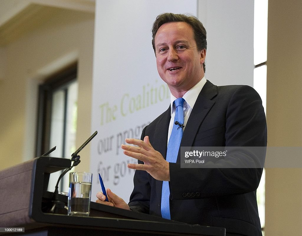 British Prime Minister David Cameron speaks during the launch of the Government Programme Coalition Agreement document as British Deputy Prime Minister Nick Clegg (L) listens on in London, May 20, 2010. The event served as platform at which the new government outlined the details agreed in the formation of the new coalition including policy areas such as the introduction of a banking levy and plans to rein in bonuses in the financial services sector.