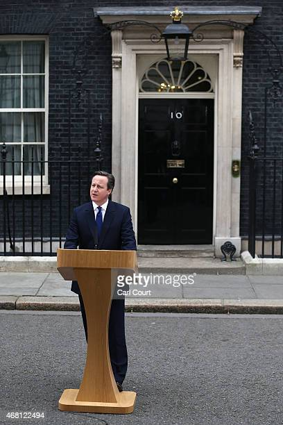 British Prime Minister David Cameron speaks in front of 10 Downing Street after meeting with Queen Elizabeth II on March 30 2015 in London England...