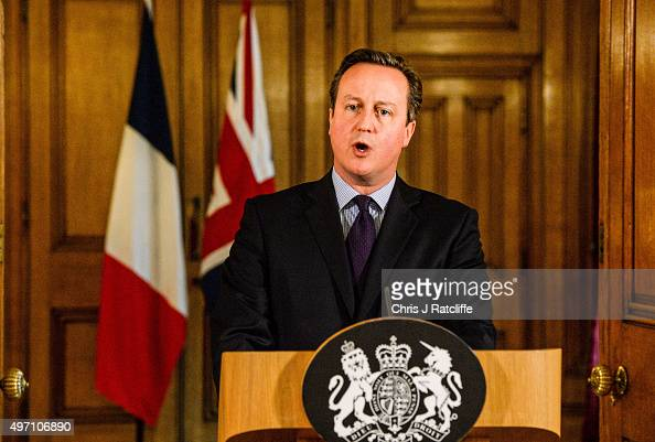British Prime Minister David Cameron speaks in the State Dining Room of 10 Downing Street after chairing an emergency Cobra meeting on November 14...