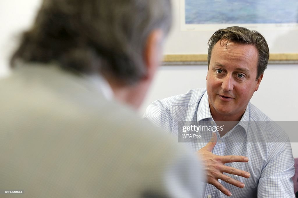 British Prime Minister <a gi-track='captionPersonalityLinkClicked' href=/galleries/search?phrase=David+Cameron+-+Politician&family=editorial&specificpeople=227076 ng-click='$event.stopPropagation()'>David Cameron</a> (R) speaks to cancer patients during a visit to the children's cancer ward at the John Radcliffe Hospital on September 28, 2013 in Oxford, United Kingdom. The Prime Minister has pledged £400m to the Cancer Drugs Fund, enabling cancer patients to access life-enhancing drugs before the NHS approves them for wide-spread use until 2016.