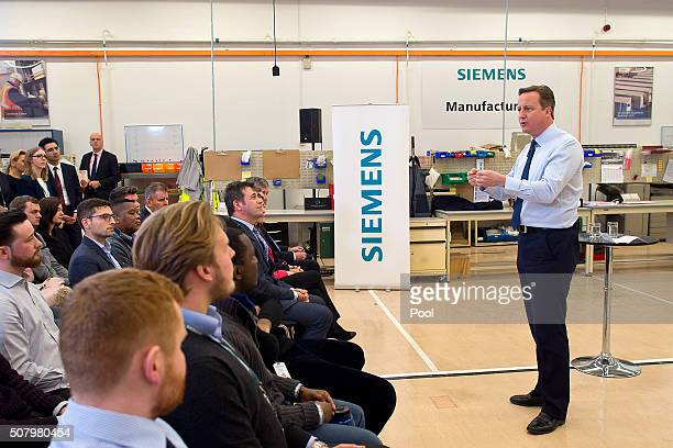 British Prime Minister David Cameron speaks to factory staff at the Siemens manufacturing plant on February 2 2016 in Chippenham west England British...