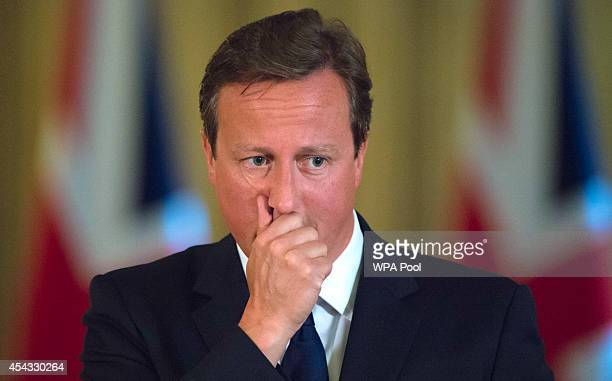 British Prime Minister David Cameron speaks to the media during a press conference at Downing Street on August 29 2014 in London United Kingdom The...