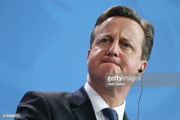 British Prime Minister David Cameron speaks to the media with German Chancellor Angela Merkel following talks at the Chancellery on May 29 2015 in...