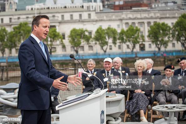 British Prime Minister David Cameron speaks to veterans aboard the HMS Belfast during 70th anniversary DDay commemorations on May 20 2014 in London...