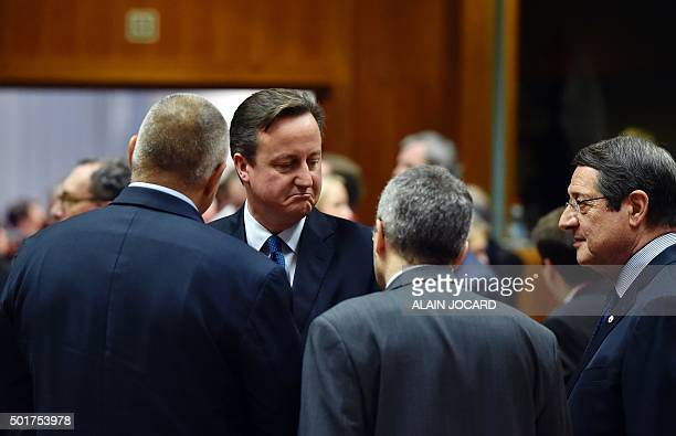 British Prime Minister David Cameron speaks with Bulgarian president Rosen Plevneliev and Cyprus' President Nicos Anastasiades before the final...