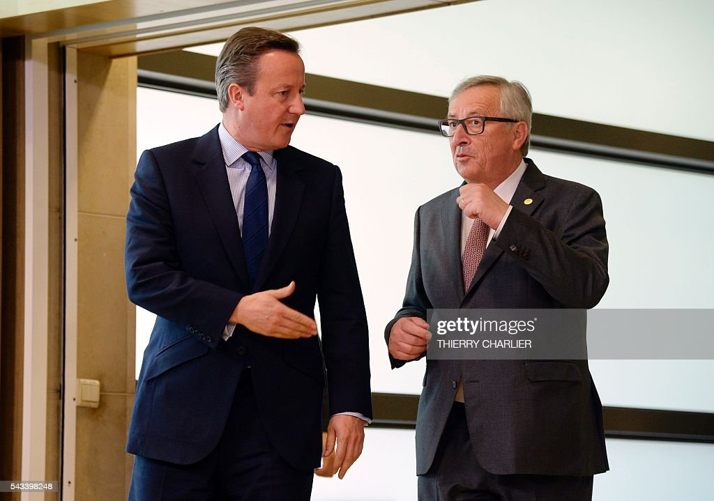 British Prime Minister David Cameron (L) speaks with European Union Commission President Jean-Claude Juncker (R) prior to a meeting at the European Union Commission headquarters in Brussels on June 28, 2016. / AFP / THIERRY