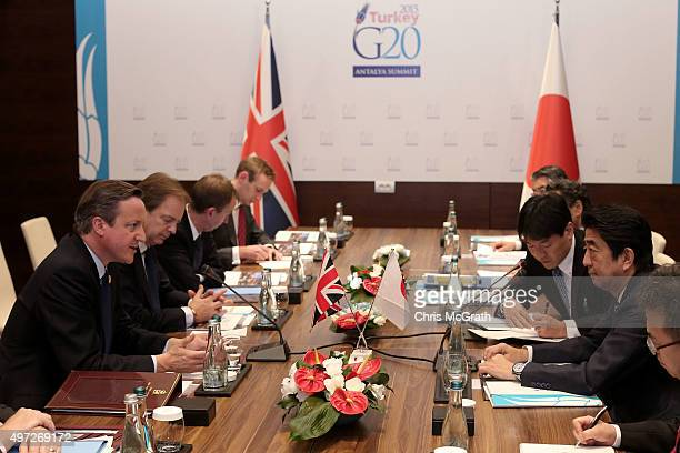 British Prime Minister David Cameron speaks with Japanese Prime Minister Shinzo Abe during a bilateral meeting on day one of the G20 Turkey Leaders...