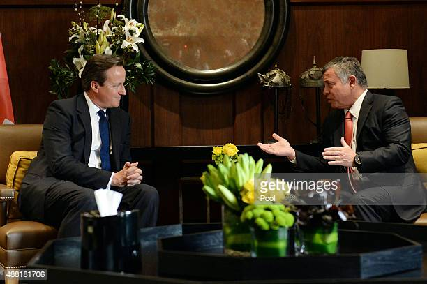 British Prime Minister David Cameron speaks with King Abdullah of Jordan in Amman on September 14 2015 in Jordan Mr Cameron said there was a 'direct...