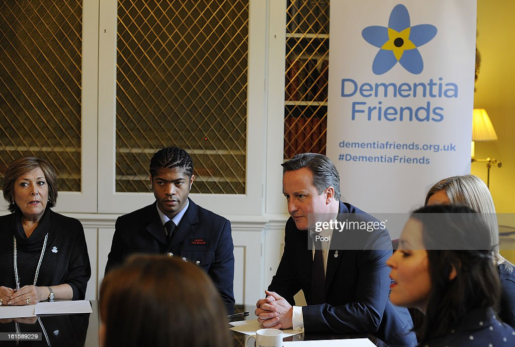 British Prime Minister David Cameron (C) speaks with representatives of Alzheimer's Society Dementia Friends during an information session in Downing Street on February 12, 2013 in London, England