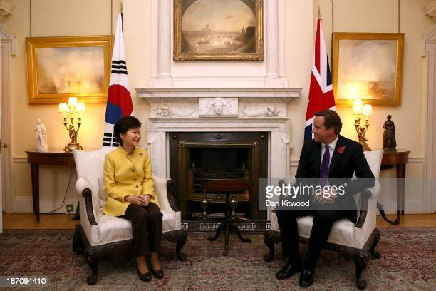 British Prime Minister David Cameron speaks with South Korea's President Park GeunHye inside 10 Downing Street in London on November 6 2013 in London...