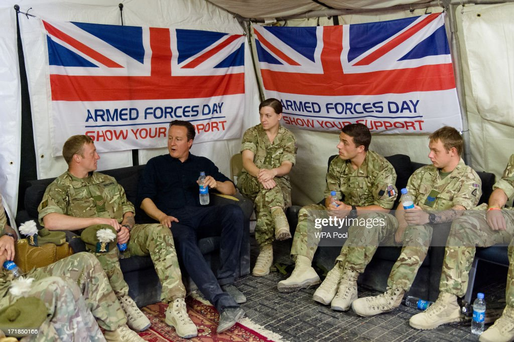 British Prime Minister David Cameron speaks with troops during a visit to Camp Bastion on June 29 2013 near Lashkar Gah in the southern Helmand...