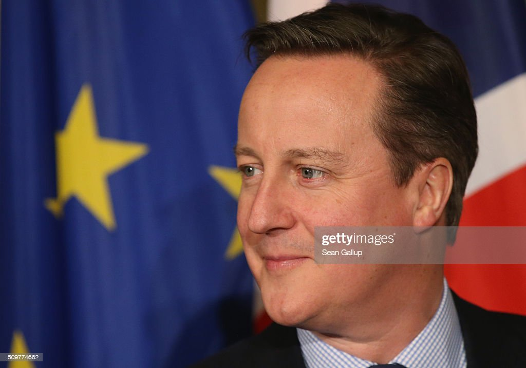 British Prime Minister <a gi-track='captionPersonalityLinkClicked' href=/galleries/search?phrase=David+Cameron+-+Politician&family=editorial&specificpeople=227076 ng-click='$event.stopPropagation()'>David Cameron</a> stands next to a flag of the European Union as he attends the annual Matthiae-Mahl dinner at Hamburg City Hall on February 12, 2016 in Hamburg, Germany. Cameron and German Chancellor Angela Merkel are there on the invitation of Hamburg Mayor Olaf Scholz, who reportedly saw the dinner as a gesture to show Germany's hope that Great Britain will remain in the European Union. The Matthiae-Mahl is a Hamburg tradition dating back to 1356 and began as a fest to welcome the spring season and also to honor a foreign official.