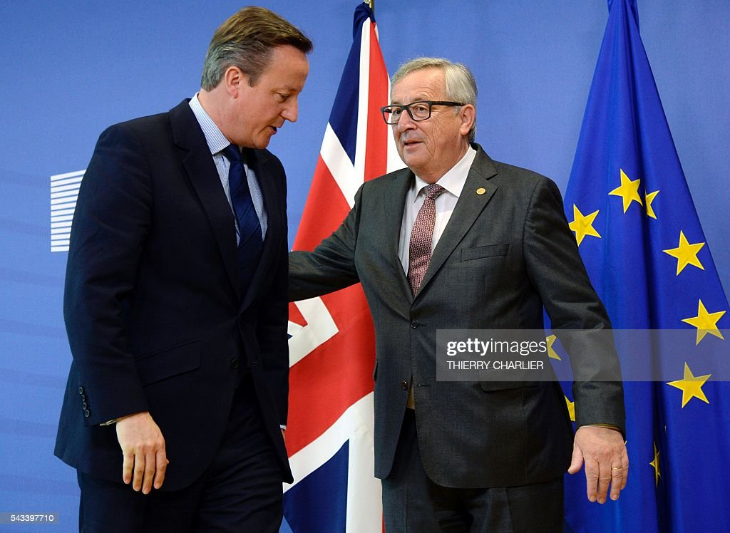 British Prime Minister David Cameron (L) stands next to European Union Commission President Jean-Claude Juncker (R) prior to a meeting at the European Union Commission headquarters in Brussels on June 28, 2016. / AFP / THIERRY