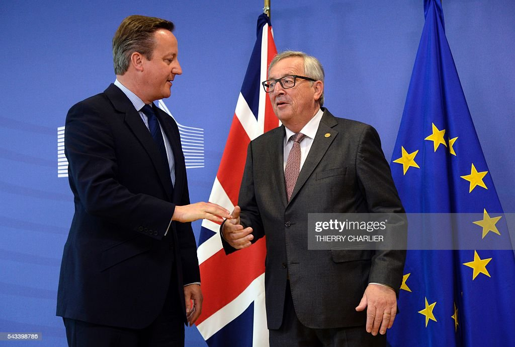 British Prime Minister David Cameron (L) stands with European Union Commission President Jean-Claude Juncker (R) prior to a meeting at the European Union Commission headquarter in Brussels on June 28, 2016. / AFP / THIERRY