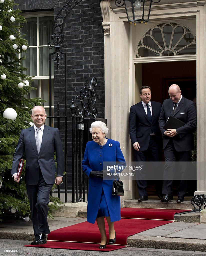 British Prime Minister David Cameron (back L) talks at the door as Britain's Foreign Secretary William Hague (L) walks with Queen Elizabeth II (C) as they depart No 10 Downing Street in central London December 18, 2012 after the monarch sat in as an observer during a meeting of the Cabinet. Queen Elizabeth II attended her first-ever cabinet meeting on Tuesday to mark her diamond jubilee, the only monarch to do so since 1781.The 86-year-old sovereign sat in as an observer on the meeting and received a gift from the Cabinet to celebrate her 60 years on the throne.