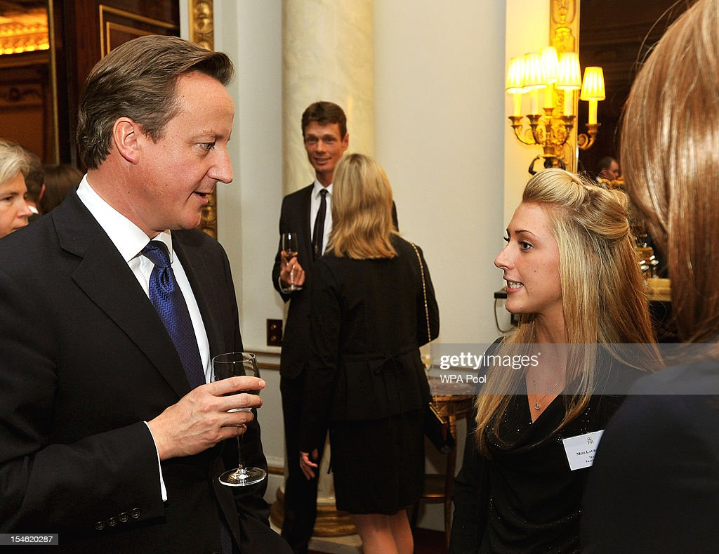 British Prime Minister David Cameron talks to cyclist Laura Trott (R) during a reception held for Team GB Olympic and Paralympic London 2012 medalists at Buckingham Palace on October 23, 2012 in London, England.