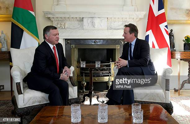 British Prime Minister David Cameron talks to King Abdullah II of Jordan at Downing Street on June 23 2015 in London England The King is visiting...