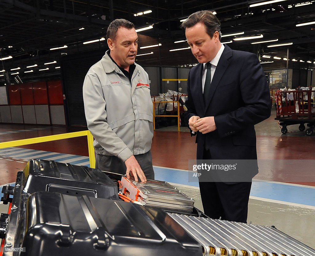 British Prime Minister David Cameron (R) talks to Production Supervisor Paul Kerry (L) as they look at a battery used to power the Nissan Leaf electric vehicle during a visit to the Nissan factory in Sunderland, northeast England on March 28, 2013. Cameron visited the Sunderland manufacturing plant of Japanese auto-maker Nissan in Sunderland on March 28 as it was announced that the factor will start production of the Leaf electric vehicle.
