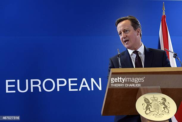 British Prime Minister David Cameron talks to the media at the end of a European Union Summit held at the EU Council building in Brussels on March 20...