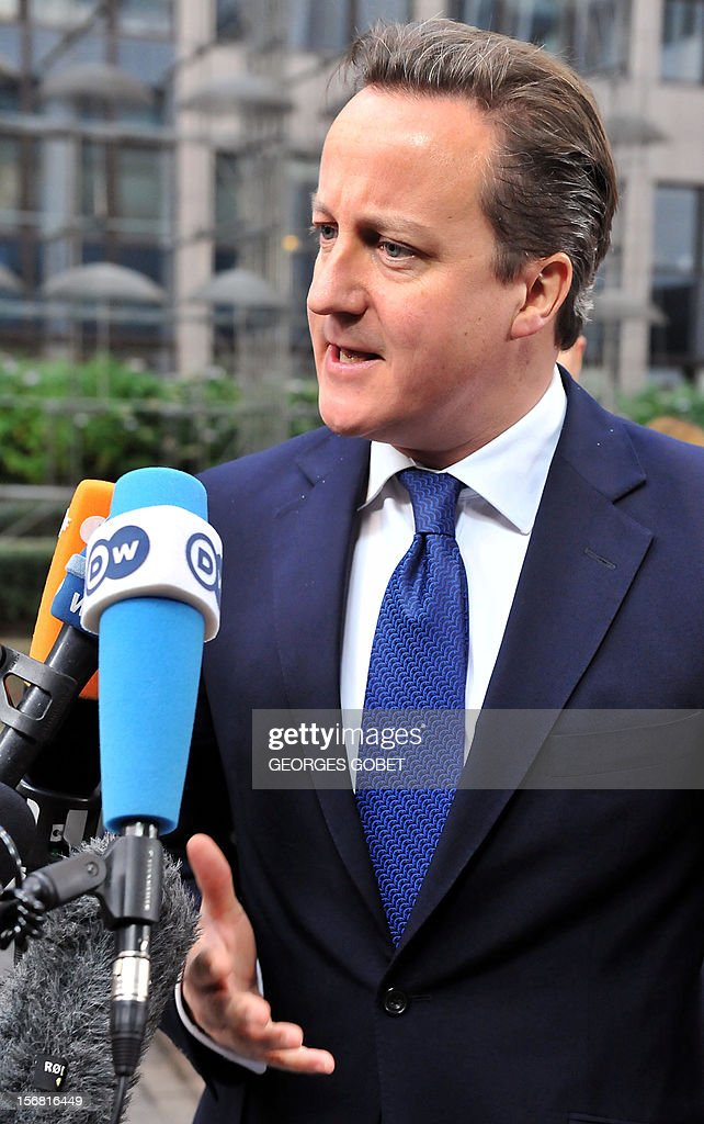 British Prime Minister David Cameron talks to the press as he arrives for a two-day European Union leaders summit called to agree a hotly-contested trillion-euro budget through 2020, on November 22, 2012 at the EU Headquarters in Brussels. AFP PHOTO / GEORGES GOBET