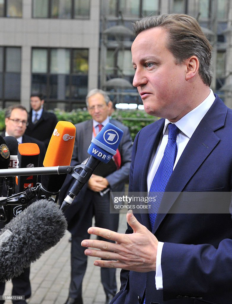 British Prime Minister David Cameron talks to the press as he arrives at the EU Headquarters on November 23, 2012 in Brussels, to take part in a two-day European Union leaders summit called to agree a hotly-contested trillion-euro budget through 2020. European leaders voiced pessimism on reaching a deal on a trillion-euro EU budget, as gruelling talks pushed into a second day with little prospect of bridging bitter divisions. AFP PHOTO / GEORGES GOBET